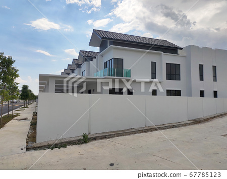 SEREMBAN, MALAYSIA -APRIL 08, 2020: New double story luxury terrace house in Malaysia.  Designed by an architect with a modern and contemporary style. Ready to receive occupants. 67785123