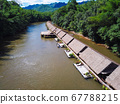 floating raft house on Kwai River in Thailand 67788215