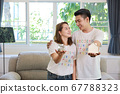 Asian spouses father and mother are showing house and money. 67788323