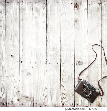 Analog camera and white wood background 67789830