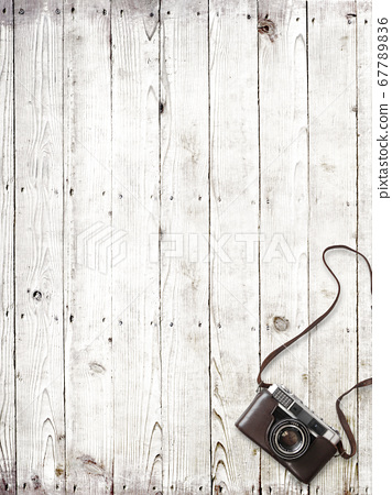 Analog camera and white wood background 67789836
