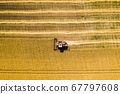Aerial view of combine harvesters on wheat field. Industrial background on agricultural theme. 67797608
