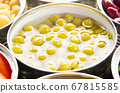 Canned green peas in just opened tin can. 67815585