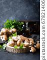Raw mushrooms champignons on black background, 67821406