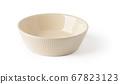 Empty beige ceramic bowl or ramekin isolated on a white background. 67823123
