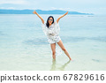 Happy girl on the beach 67829616