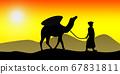 Camel caravan going through the sand dunes 67831811