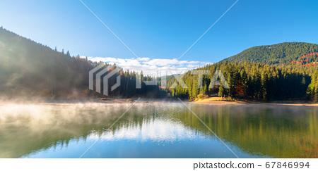 lake landscape at foggy sunrise. misty scenery 67846994