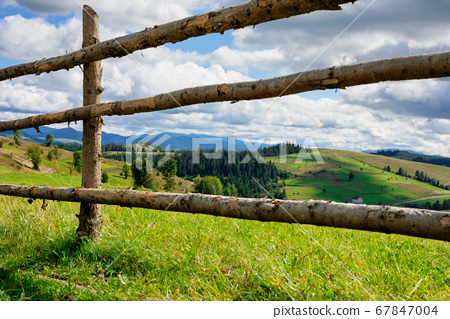 fence on the hill in rural area. early autumn 67847004