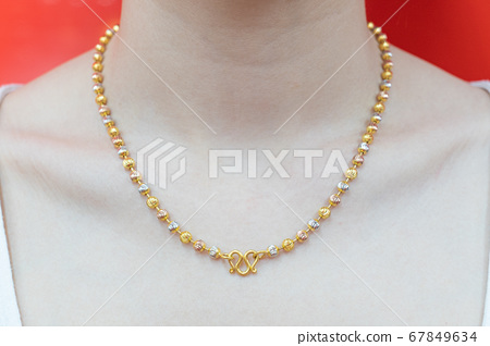 Beautiful neck girl with gold necklace. 67849634