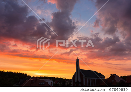 Beautiful sunset in the sky with church 67849650