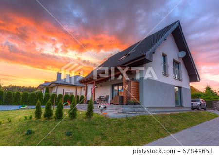 A modern single family house with a garden 67849651