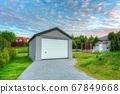 Free standing garage in the garden at sunset 67849668