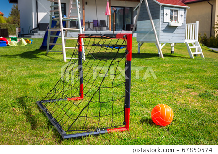 Garden playground for children with a mini soccer 67850674