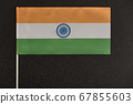 Table flag of India on black background. National 67855603