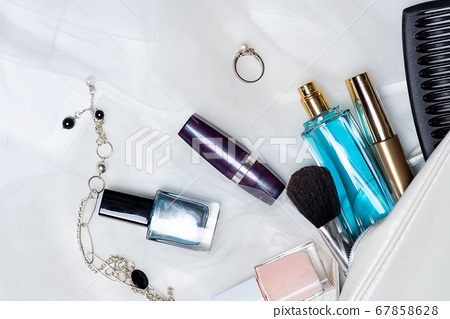 Various cosmetic products falling out of an female 67858628