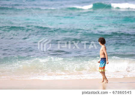 Child enjoying the blue sea 67860545
