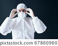 Doctor in PPE wearing protective glasses on black background 67860960