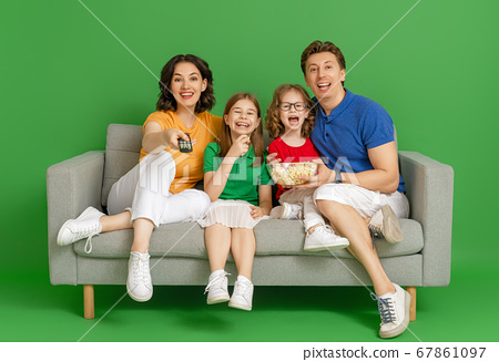 Happy loving family on bright color background. 67861097