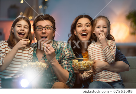 Mother, father and daughters spending time 67861099