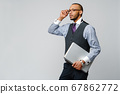 professional african-american business man holding laptop computer 67862772