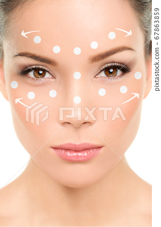Beauty woman applying makeup or face cream lotion. How to apply concealer technique demonstration 67863859
