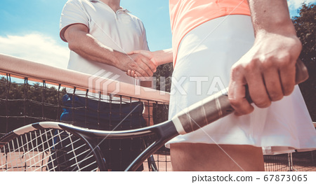 Professional tennis players shaking hands before the match, competition, sport concept 67873065