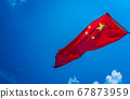 Red Chinese national flag with blue sky background 67873959
