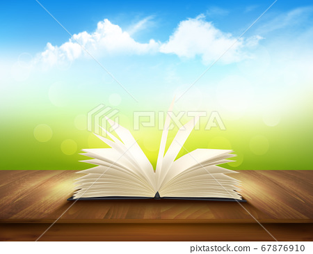 Open book on a wooden deck with green and blue 67876910