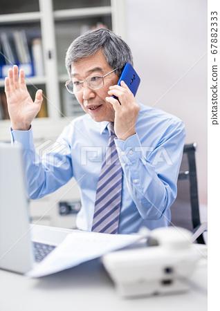 asian man speak on smartphone 67882333