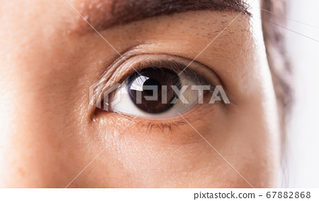 Close up of iris eyebrow or eyes Asian young woman 67882868