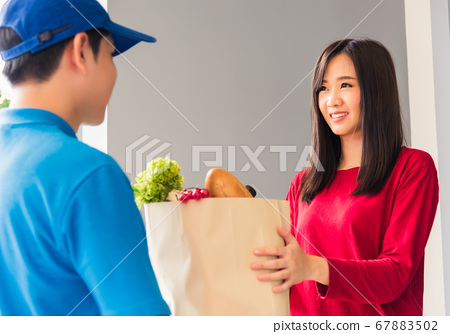 Delivery man making grocery giving fresh food to 67883502