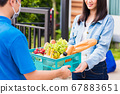 Delivery man wear face mask grocery fast service 67883651
