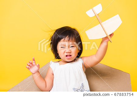 Kid little girl smile wear pilot hat play with toy 67883754
