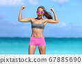 Strong fitness woman flexing biceps success 67885690