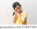 Asian girl standing and sleeping isolated on a 67887266
