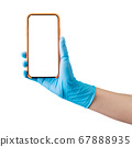 Doctor's hand in medical gloves holding phone isolated on white 67888935