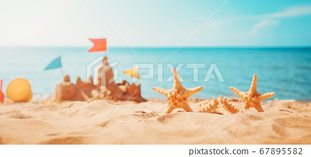 Sandcastle on the beach at sea in summertime 67895582