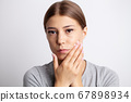 Portrait of a pretty young woman having a severe toothache 67898934