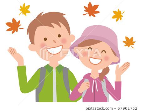 年輕夫婦享受秋天的樹葉狩獵 67901752