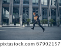Handsome businessman running fast on the street 67902157
