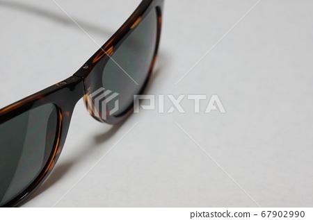 Sunglasses up alone background white 67902990