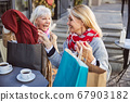 Senior women are laughing in street cafe 67903182