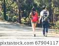 Tourism asian couple walking and exploring forest  67904117