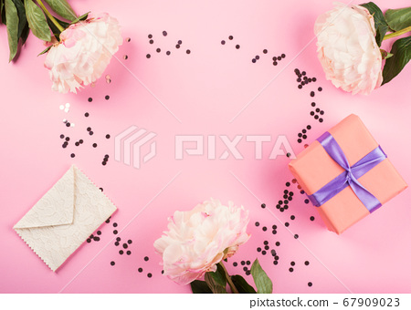 Pink pastel background with gift boxes, peonies 67909023