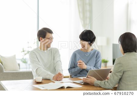 Senior couple and business woman having a business talk 67910270