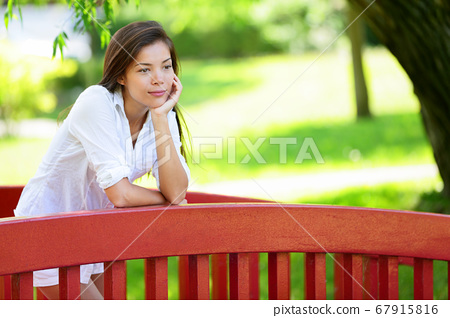 Thoughtful Young Woman Pensive At Park 67915816