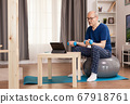 Retired person doing sports at home 67918761