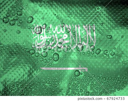 water drops on Saudi Arabia flag background 67924733