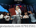 Nervous tensioned investors analyzing crisis stock market with charts on screen on background, falling stock exchange 67933561
